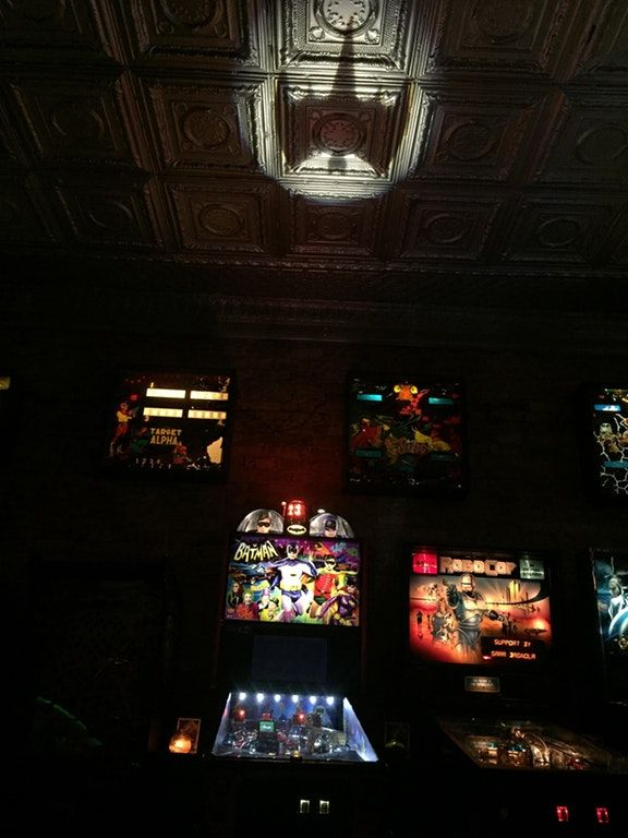 This batman pinball game has a bat signal that projects on the ceiling. : mildlyinteresting