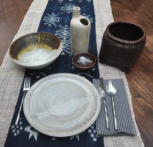 indigo ikat runner, lurikhandwoven napkins, Lombok fishing basket, handthrown ceramics