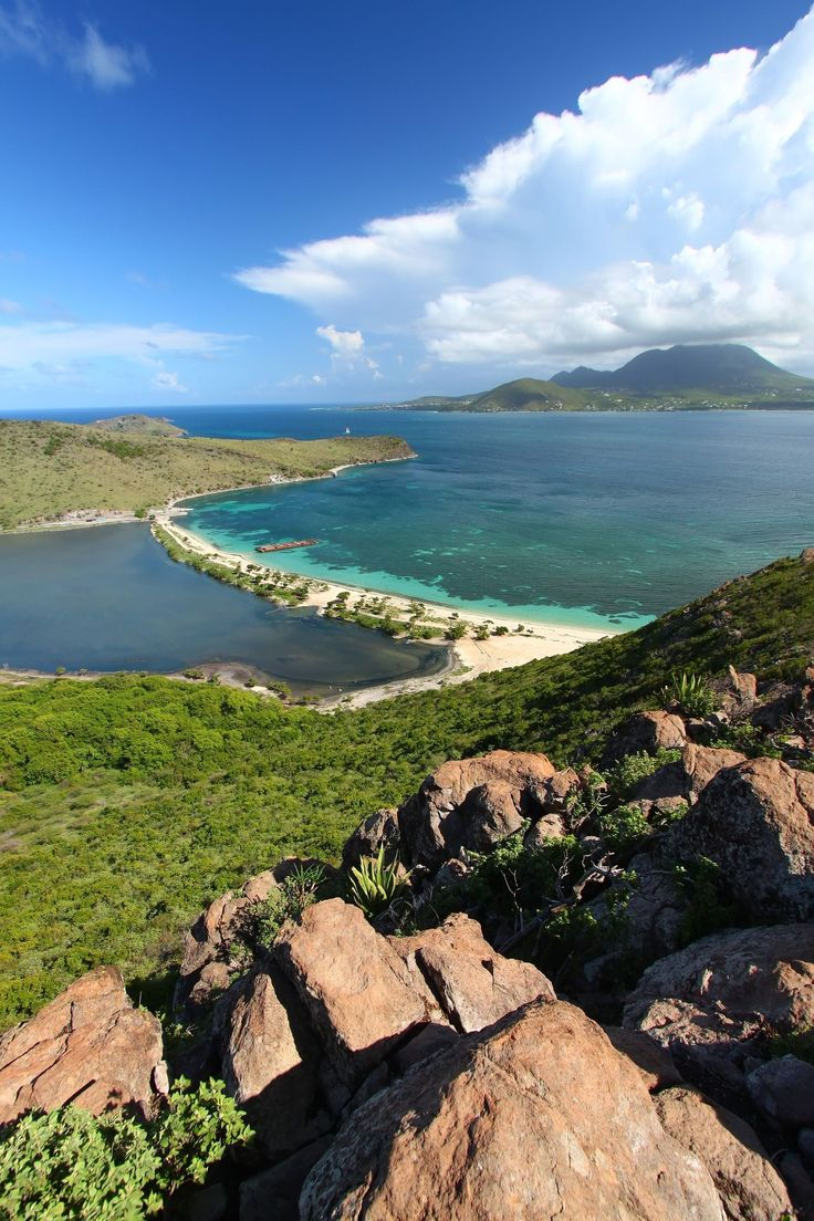 St. Kitts --a true paradise, very serene, a lot of natural beauty. There are miles and miles of undeveloped land. You see green pastures everywhere, mountains in the center of the island and gorgeous ocean views throughout.