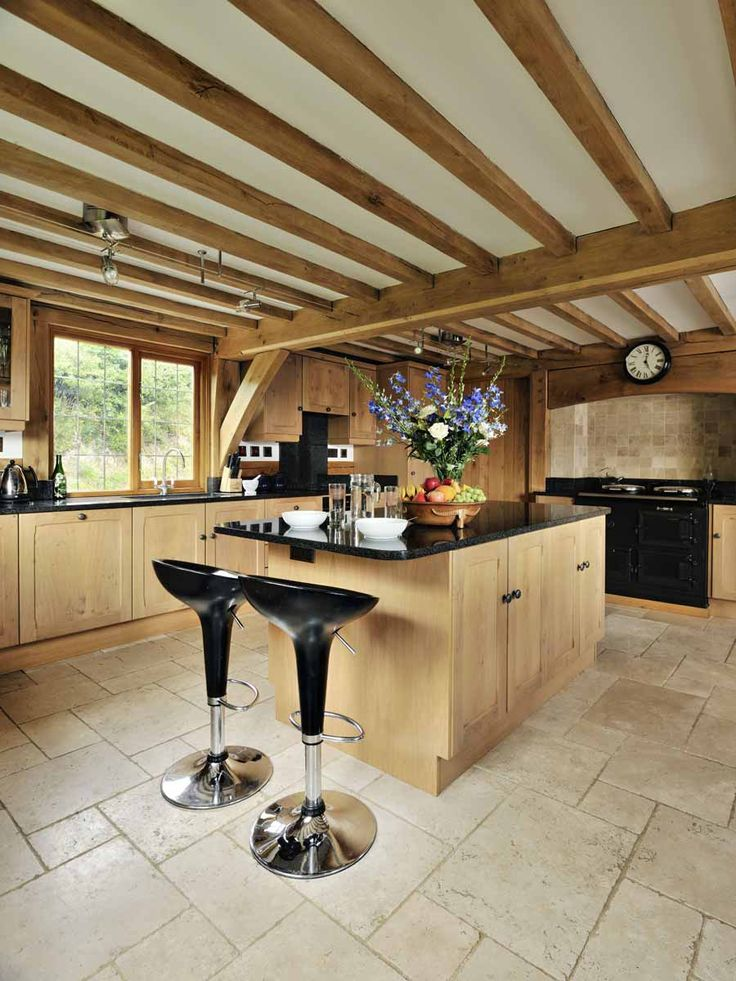 Beautiful oak frame kitchen from Welsh Oak Frame with exposed oak beams and joists. www.welshoakframe.com #oakframe #kitchenideas #traditionalkitchen #exposedbeams