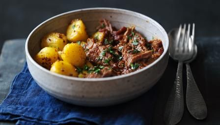 Lamb Madras with Bombay potatoes. Made this after getting my hands on a reduced in price lamb shoulder. Totally delicious, the meat was incredibly tender.