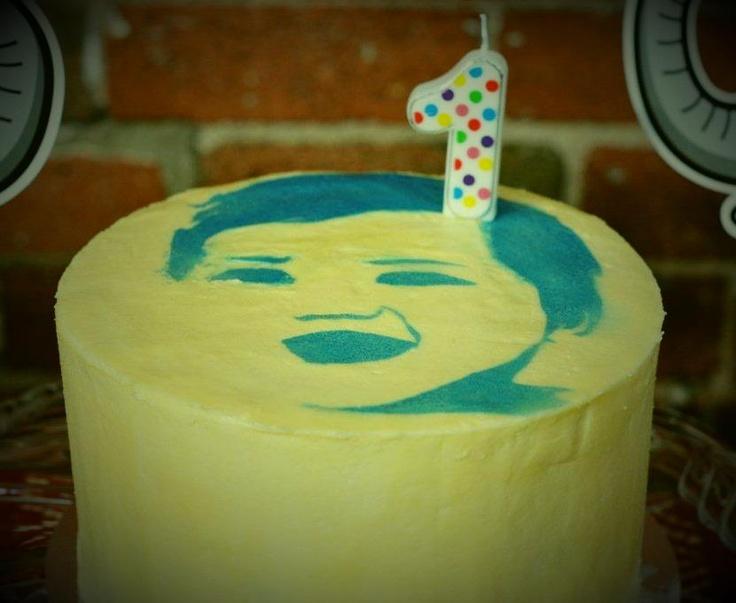 Face stencil of birthday boy on cake