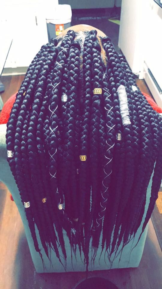 "Credit: Facebook -  ""Triangle Box braids #LetMesieDoIt™"""