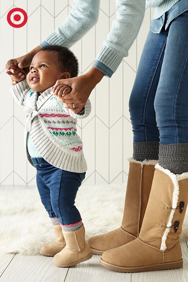 Matching faux-shearling, classic boots for Mom and Baby? Yes, please! These winter must-haves are cozy and warm, and feature a timeless style that's perfect for life on the go, or simply lounging around. So sweet!