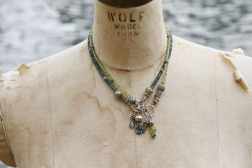 Two necklaces. A single strand of London blue topaz and a second version of the necklace in peridot.