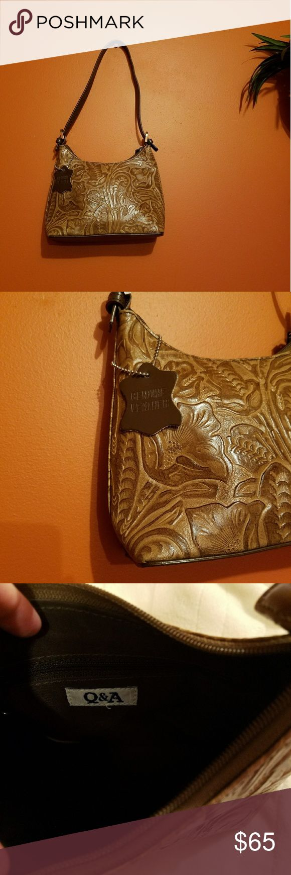 Stunning Tropical Real Leather Detail Handbag This is a reposh for my mother. She loves the design, but it's a little small for her tastes.   Features gorgeous real leather with tropical etchings. Stunning little handbag. Total length is 17 inches (with strap drop), 7.5 tall without, and 9 across. Can be slung over the shoulder as well.   Q&A brand.  Beautiful condition overall, but there is a tiny little black spot on the back (see photo) and light storage wear and scuffing on the straps…
