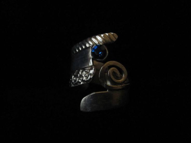 Blue Funk.  A blue Swarovski crystal adorns this funky sterling silver, hand forged ring.