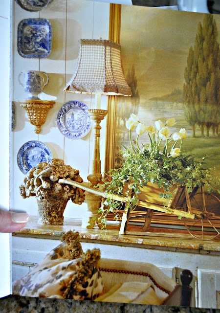 """I like the idea of flanking a painting with staggered, wall-hung plates (From the book """"Great Country French Style"""")"""