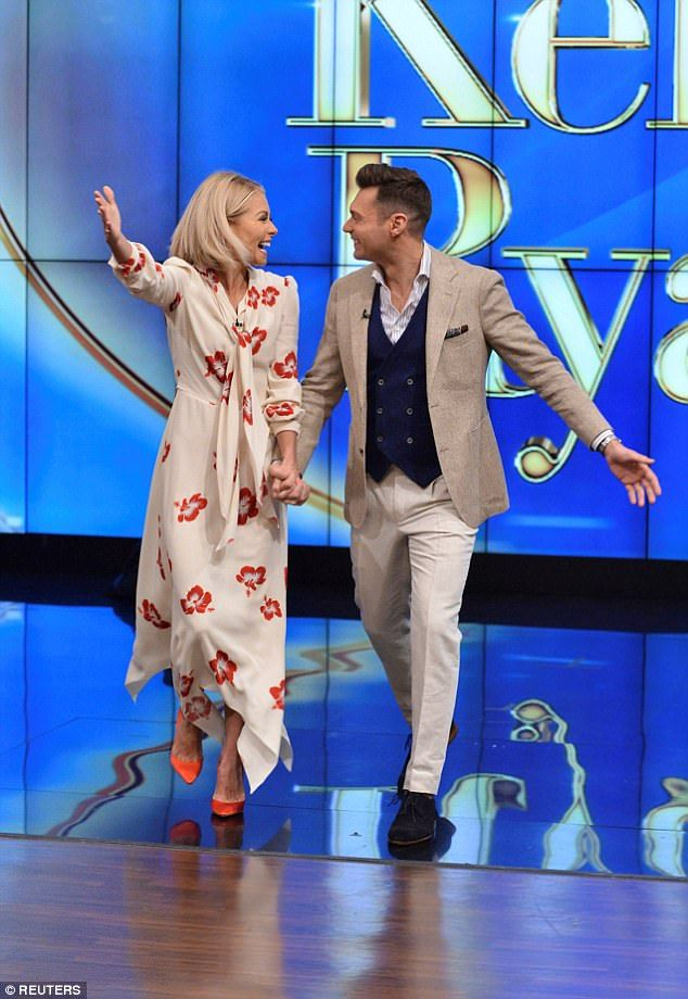 Emotional: 'I'm telling you, when I walked out there today, I almost had a tear in my eye,' Ryan Seacrest said of his first day as co-host of Live With Kelly And Ryan, alongside Kelly Ripa
