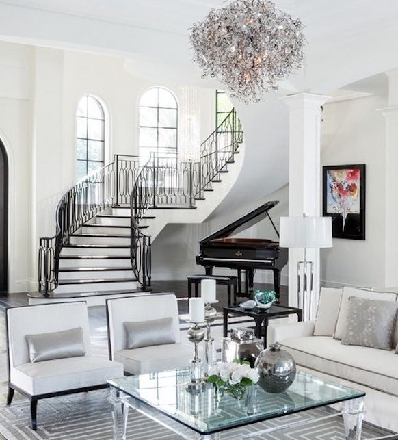 This Striking Black And White Living Room Is Grounded By An Arched