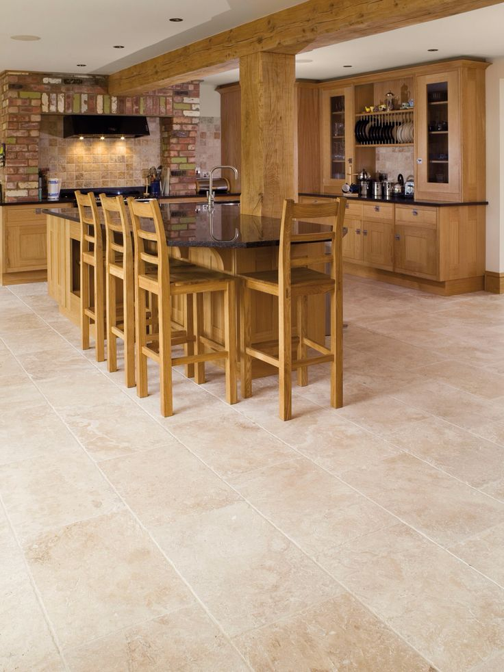 Beautiful Corinth Tumbled Travertine from Mandarin Stone. It is an essential stone for any home! It looks perfect in this kitchen against the wood. Various tile sizes and layout options. Floor and wall use. www.mandarinstone.com