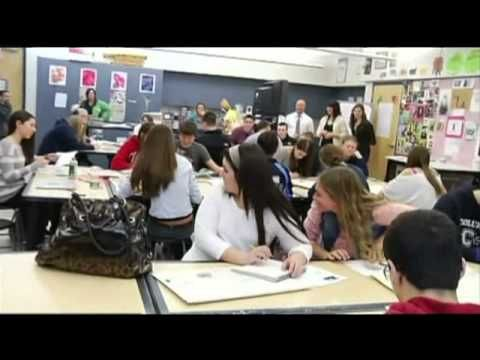 Soldier surprises daughter at high school - YouTube