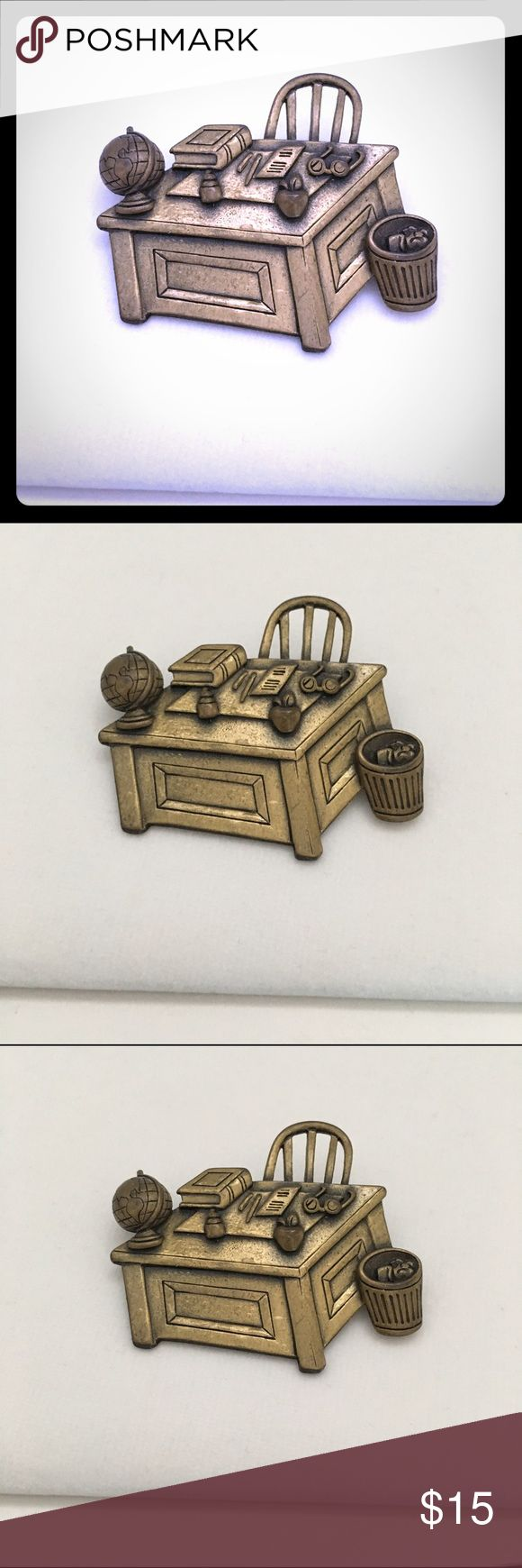 Burnished Gold School Desk Brooch 💋 Burnished Gold School Desk Brooch. Pin is a detailed description of a teacher's school desk complete with globe, apple, books and glasses. 💋15% off bundles of 3 or more.                      💋 No trades.                                                           💋 No Holds.                                                          💋 No Sales outside of Poshmark Jewelry Brooches