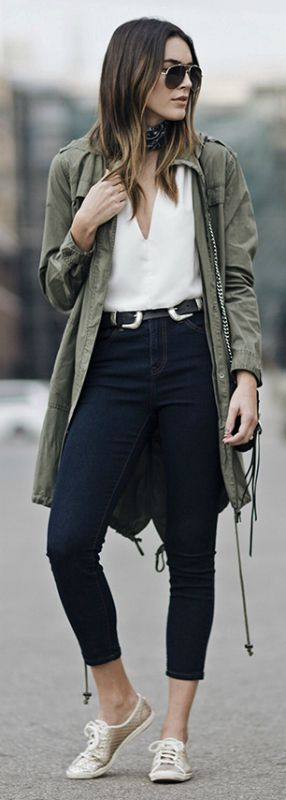Brittany Xavier + oversized Khaki anorak + soft, low necked shirt + high-waisted jean + gold Keds + causal elegance + ultimate in cool + aviators + double buckled belt + hot ticket item this season.  Jacket: Forever 21 Jeans: Forever 21, Sneakers: Keds Belt: ASOS Bag: Rebecca Minkoff, Sunglasses: Valentino