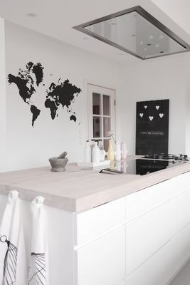 Love the beige countertop and hood hidden in ceiling