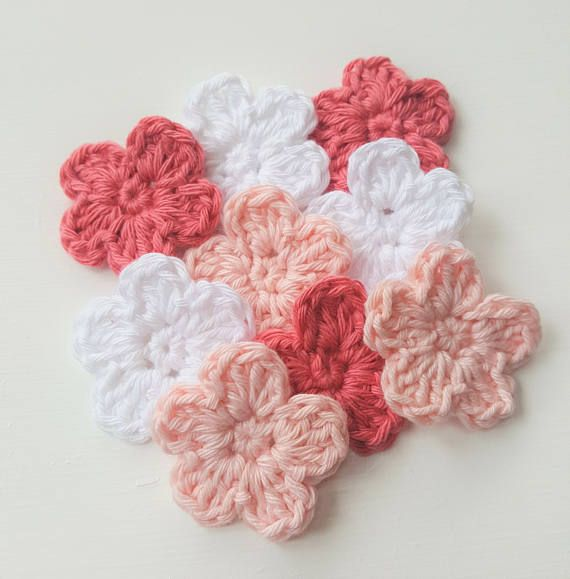 9 small crochet flowers, crocheted by hand in 100% cotton yarn. 3 in each colour: dusty pink, pale pink/peach and white  Size: 4cm wide/1.5in wide  These little flowers are ideal to embellish a wide array of items: hair accessories, brooches, sewing projects, scrapbooking, cardmaking, blankets and many others.  Custom Orders: If you would like these to be made in different colours or quantities, please contact me to discuss.