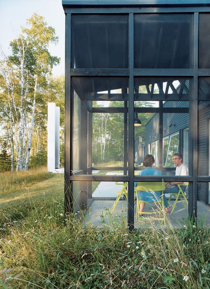 """""""Every room except the bath has huge windows."""" explains Bruce Golob. """"And although David was reluctant to design a screen porch he figured out a way to do it without interfering with any of the views."""""""