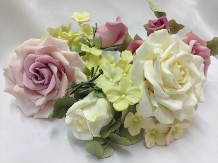 A cluster of various flowers I made for my daughters' wedding cake