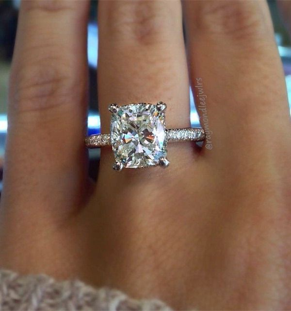 cushion Cut solitaire wedding engagement ring on a thin diamond band                                                                                                                                                     More