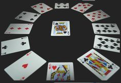 The complete rules for the solitaire card game Clock, also known as Four of a Kind, Hidden Cards, Sun Dial, and Travelers.