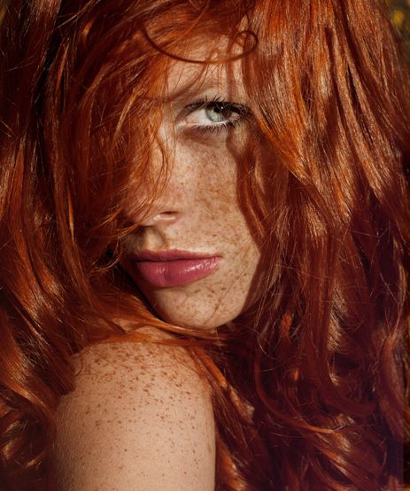 Cute redhead with freckles.