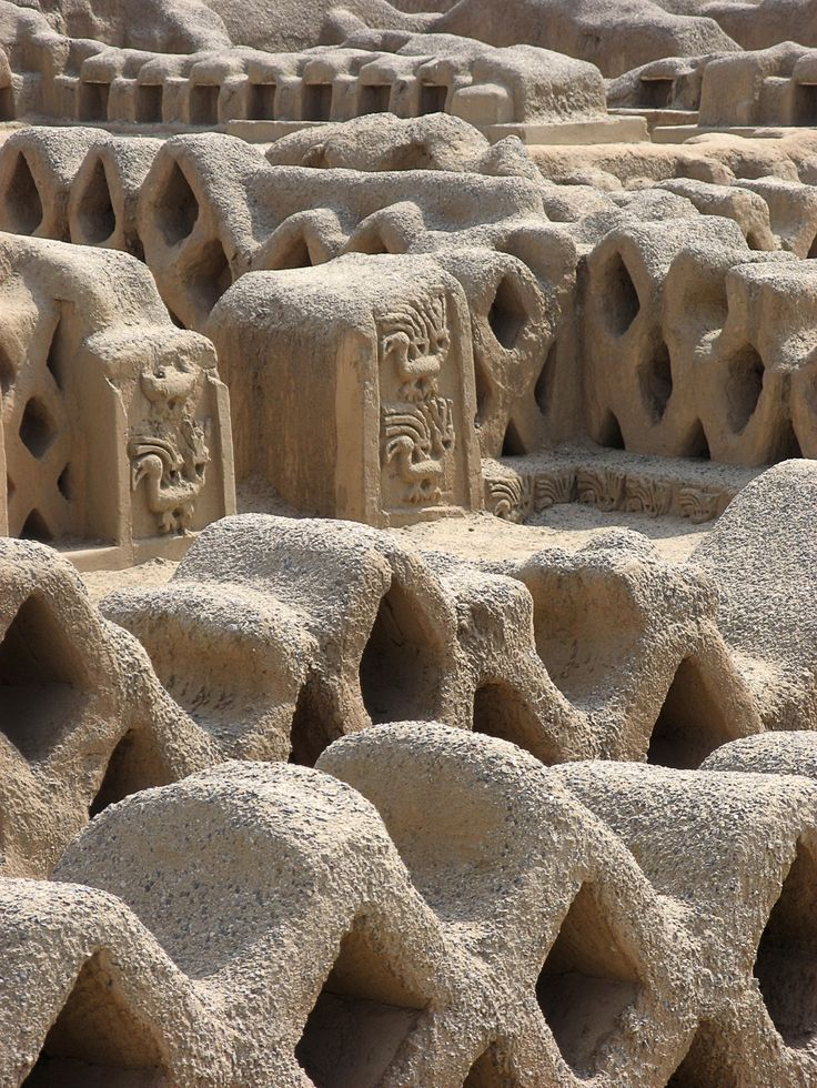 Honeycomb patterns in the ruin walls of the Chimu-dynasty city of Chan Chan in Peru. The adobe city of Chan Chan, the largest in the world, was built around AD 850 and lasted until its conquest by the Inca Empire in AD 1470. It was the imperial capital where 30,000 people lived.