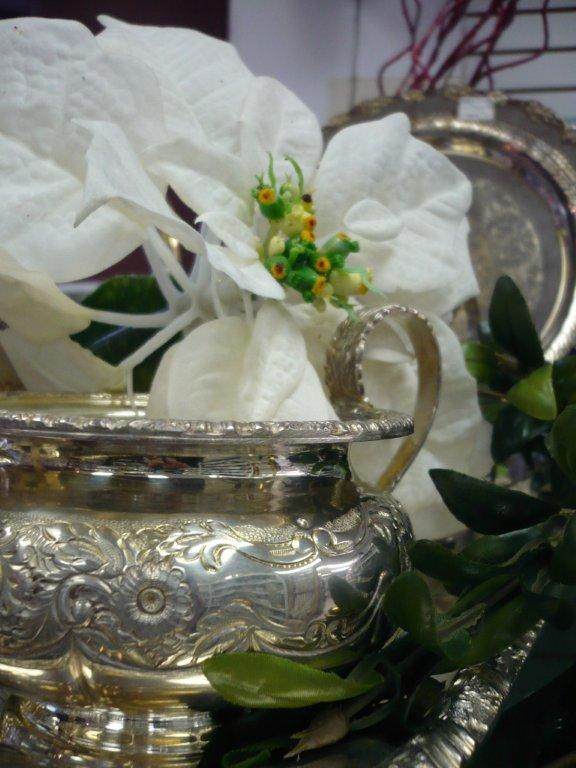 decorating inspiration: silver bowls stuffed with white poinsettia