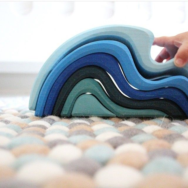 GRIMMS | these amazing wooden waves in different colours of blue are from Grimm's Toys. A German brand with wooden toys. Made by hand, oiled with natural oil and painted with water based paint. They make different stacking toys inspired by the elements, this is water.