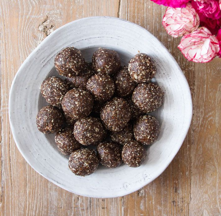 Ultimate energy balls filled with almonds, walnuts, hemp protein, flaxseed, chia seeds, coconut oil, raw cacao and medjool dates.