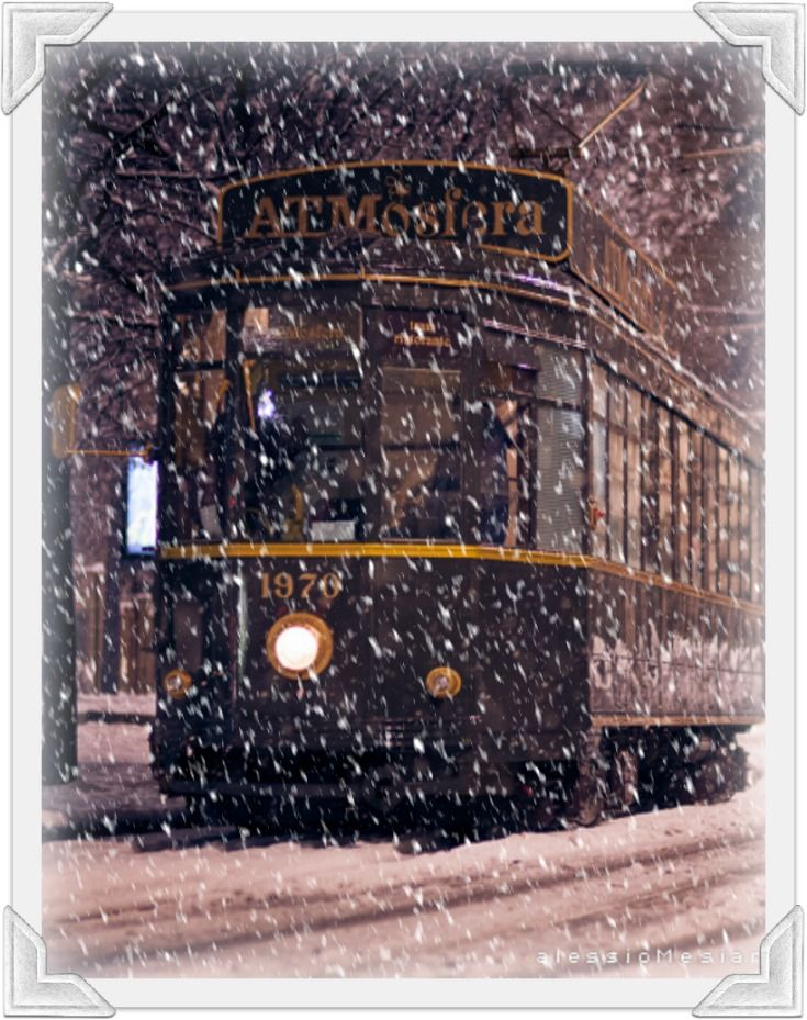 Tram ATMosfera, Milano, Italy, Snowfall.....beautiful experience as you eat on this vintage tram going around town :-) If you ever come to Milan booked at ATM.