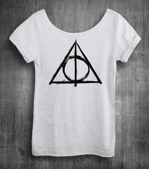 Womens Harry Potter Off The Shoulder Slouchy Tshirt featuring The Deathly Hallows! Great for Comicon, Wizarding World, Diagon Alley! In Ash White Ultrasoft Cotton tee.  ------------------------------------------------------------------------------------------------  A lightweight, 4.5 oz, supersoft 100% Ringspum Cotton shirt. Screen printed with eco-friendly, water-based, soft-hand inks. Hand crafting means each design may vary slightly.  SIZES: 1st measurement is Width is across chest…