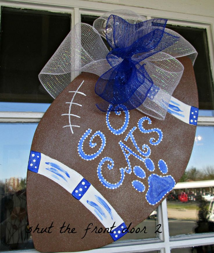 football door hanger ...(idea, with football #)