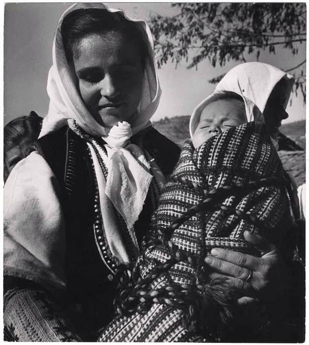 Young mother holding a baby, in Macedonian costume, Andartikon, Florina, Greece]  1950. Copyright © David Seymour/Magnum Photos