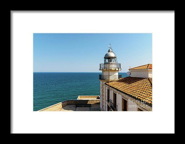 Lighthouse With Mediterranean Sea As Background Framed Print