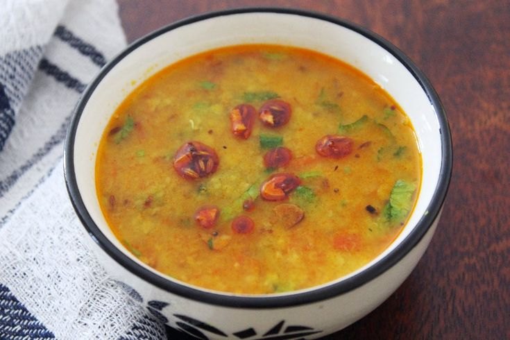 Dal is quintessential part of the Indian Cuisine and every region and household has its own variation of preparing the same. ThisSindhi Arhar Dal Recipe is a simple dal cooked everyday in a Sindhi household. Though the process of making a simple dal tadka remains the same, what makes it different from the other arhar or toor dal recipe is the use of the dry mango in this recipe. Dry mango/Amchur Powder adds a beautiful light tartness to the dal. The arhar or toor dal is first p...