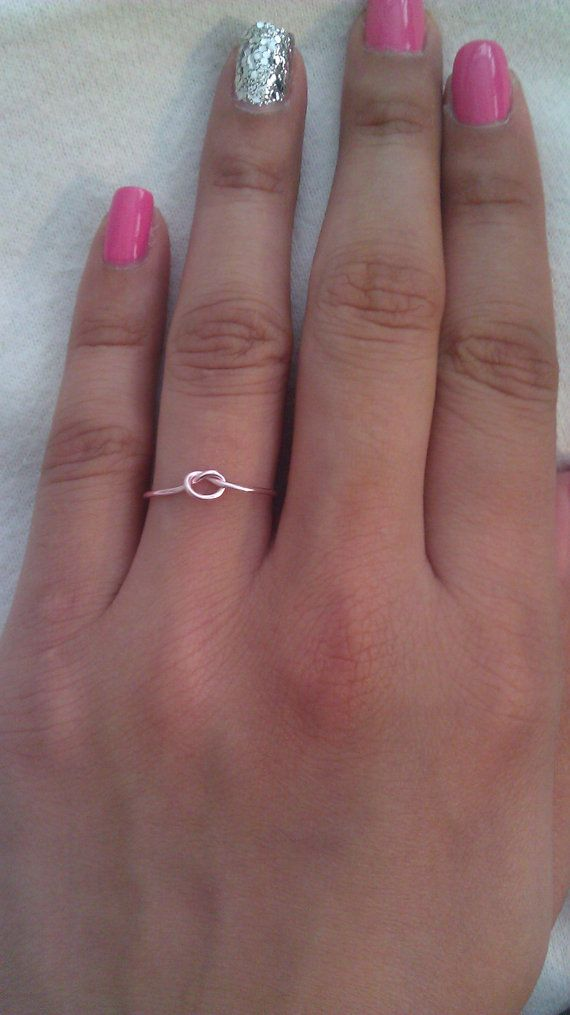 This dainty knot ring is handcrafted from 20 gauge wire. It is available in either rose gold, pink, silver or gold plated non-tarnishing