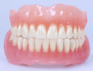Risk of Pneumonia in the Elderly Doubled by Sleeping in Dentures