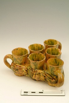 Fuddling Cups Production Date:  1766  A 3-D puzzle in the form of linked cups. The challenge is to drink from the vessel in such a way that the beverage does not spill. To do this successfully, the cups must be drunk from in a specific order.