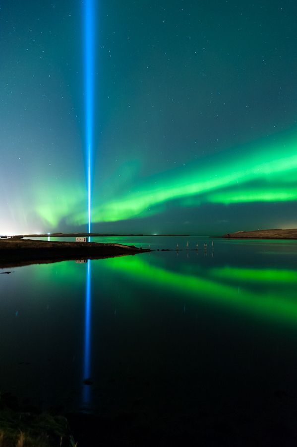 Light in the sky. The northern lights in Iceland and the light from Yoko Ono Peace Tower. Learn more about the northern lights in Iceland here: http://www.northernlightsiceland.com/