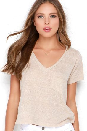 Look and feel comfy whether you're being a daredevil or having a relaxing day with your girls in the High Dive Beige Burnout Crop Tee! This soft, knit burnout tee has a plunging V neck, short sleeves, small front patch pocket, and an adorable cropped hem. Perfect for pairing with your favorite distressed skinny jeans! Unlined. 50% Polyester, 38% Cotton, 12% Rayon. Hand Wash Cold. Made With Love in the U.S.A.