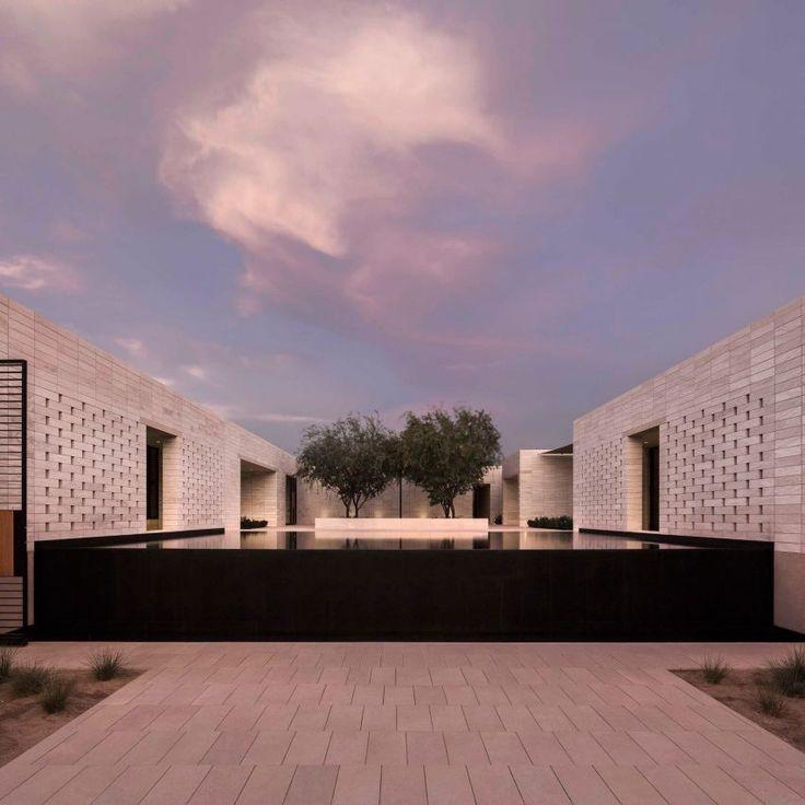 Limestone walls define sequence of courtyards at Arizona desert home by MASAstudio