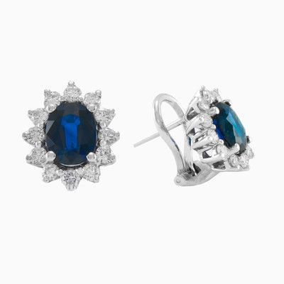 This elegant, classic pair of sapphire and diamond earrings are made in 18k white gold. Each earring features an oval shaped blue sapphire with a total combined weight of 2.46ct . The sapphires are complemented with round brilliant cut diamonds with a total weight 0.76ct