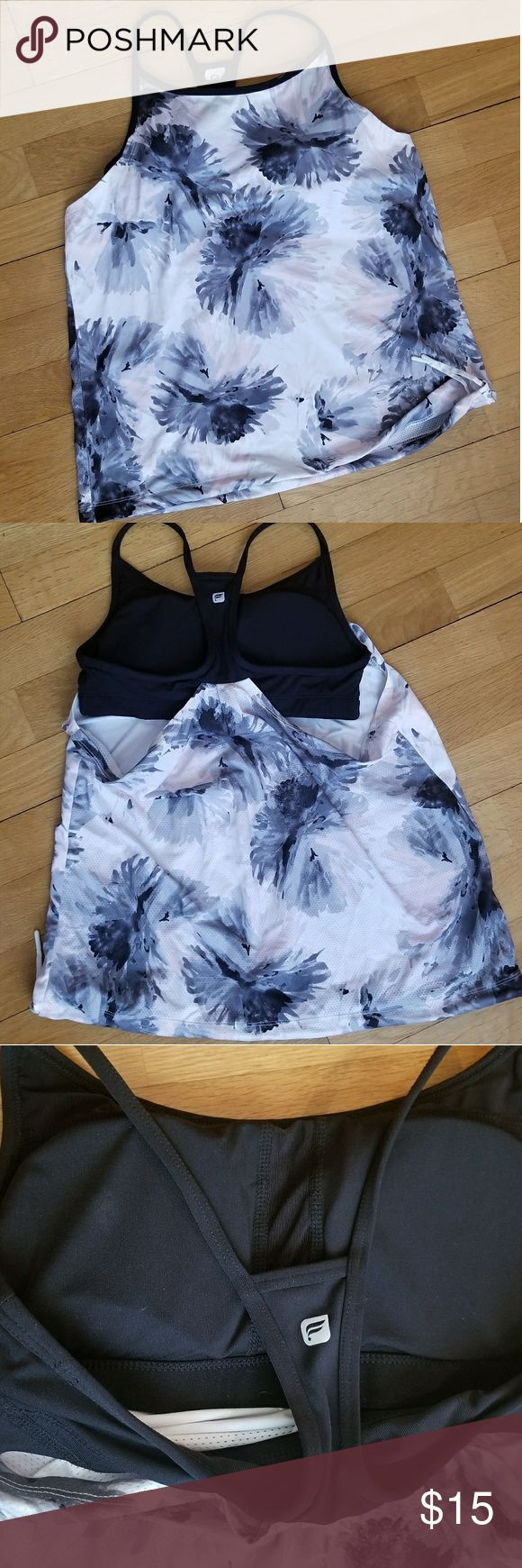 Fabletics tank Flowy tank, able to be cinched and tied at the bottom. Pink/grey/white light flowered fabric with built in padded black bra. Open back around the bra, perfect for hot summers! Fabletics Tops Tank Tops