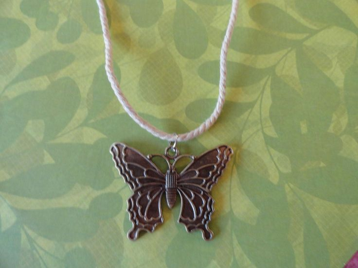 Butterfly burnished antque  gold pendent 50% OFF. Unique butterfly pendant is made from antique gold metal . hand on 18 inch beige rope Metal plated WAS $10.50