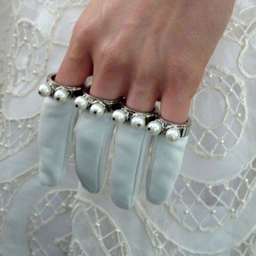 Gloves at Alexander McQueen Fall/Winter 2013. - Is it just me or do these look like googly eyed finger puppets?