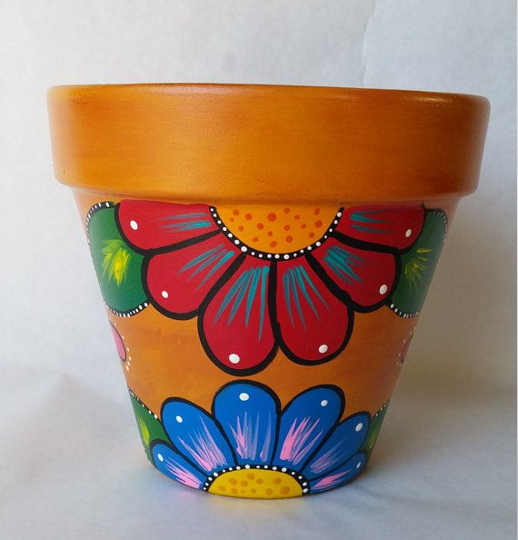 Rustic style hand painted pot.Vibrant and Colorful! ***You will receive one like the one in the picture. I hand paint my pots and do not use stencils so slight variations may occur.*** This flower pot was painted using a technique that gives it a washed out worn look pot that is very beautiful. It has a deep gold color with a burnt red under tone. Beautiful hand painted flowers complete this fun pot! Acrylic paint and poly sealed Measures 7 inches by 7 1/2 This pot is a made to order pot and…