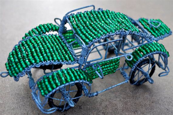 African Beaded Car bead & wire sculpture by akwaabaAfrica on Etsy, $20.00 These rustic African cars look great in ornamental displays or as coffee table ornaments.