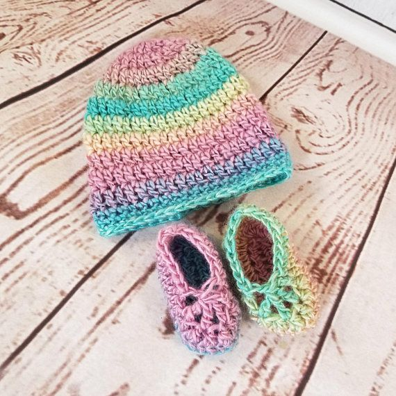 The perfect set for your new baby baby to accessorize with. This rainbow beanie hat and matching slippers are bright and fun for the newest little bundle of joy in your life! Fits standard 0-3 months sizing. WASHING INSTRUCTIONS Made of durable yet soft acrylic yarn. Machine washable and dryable!  SHIPPING This is a pre-made, ready to ship item and will ship within 2 business days of placing your order. SHIPS FREE in the US with the purchase of any other item.  SHOP MORE See additional…