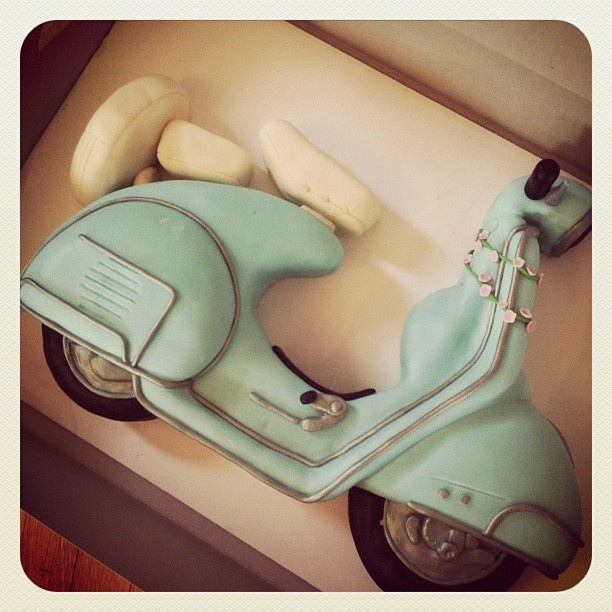 A retro vespa cake for a client. It is an entirely hand carved cake underneath. by Sweet Fix, via Flickr