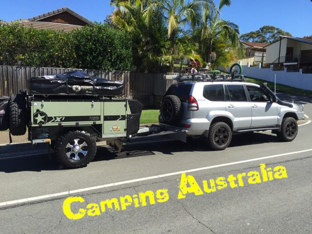 Camping Australia. Patriot Camper and Toyota prado making a dash for the hills.
